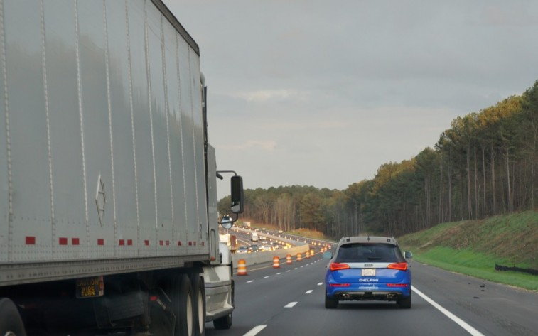 The self-driving Delphi Audi passes a semi on its autonomous trip from California to New York in 2015