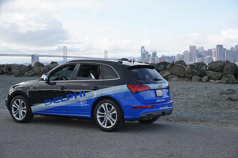 autonomous-driving-vehicle-parked-with-san-francisco-in-background