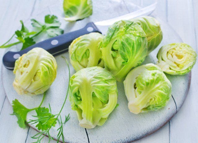 using a paring knife to trim Brussels sprouts