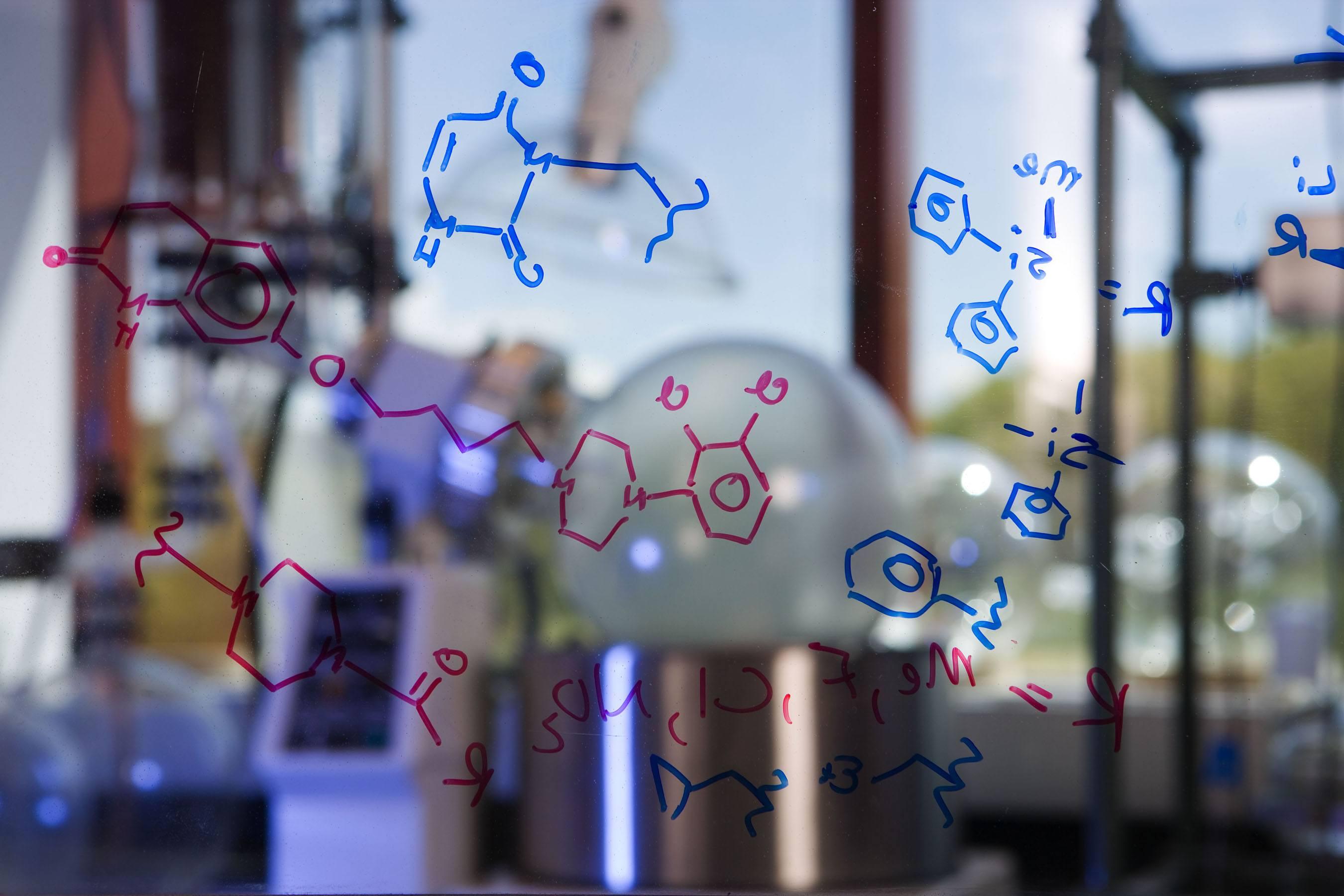Chemical formulas written on glass
