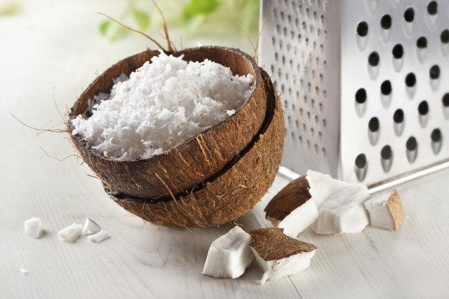 coconut grated in a coconut shell