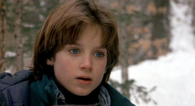 Elijah Wood stands outside in The Good Son