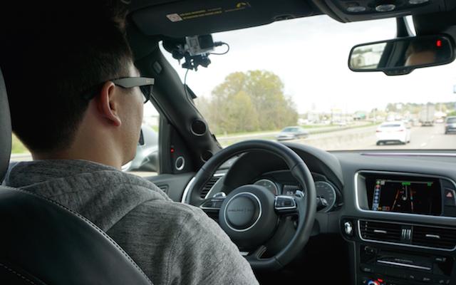 inside-the-autonomous-car-with-driver.jpg