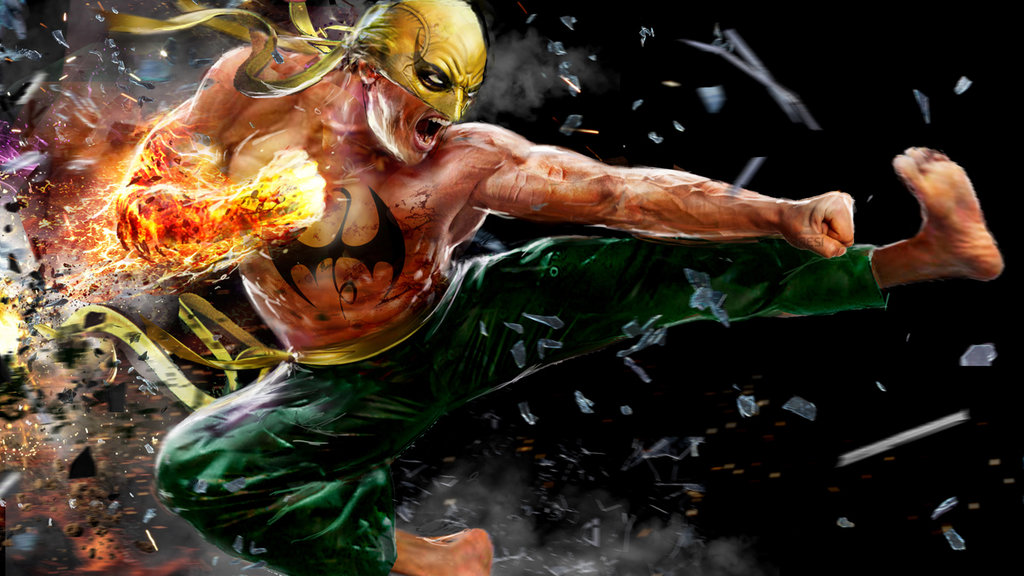 Iron Fist in full costume and with glowing hand about to deliver a blow