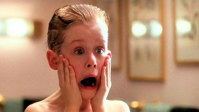 Young Macaulay Culkin makes a surprised face in a famous scene from Home Alone