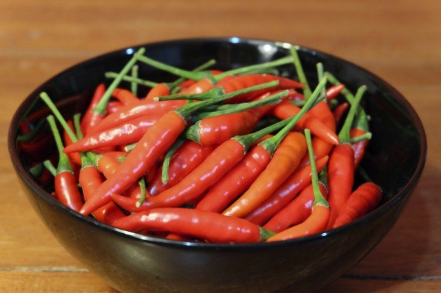 bowl filled with spicy Thai chilies
