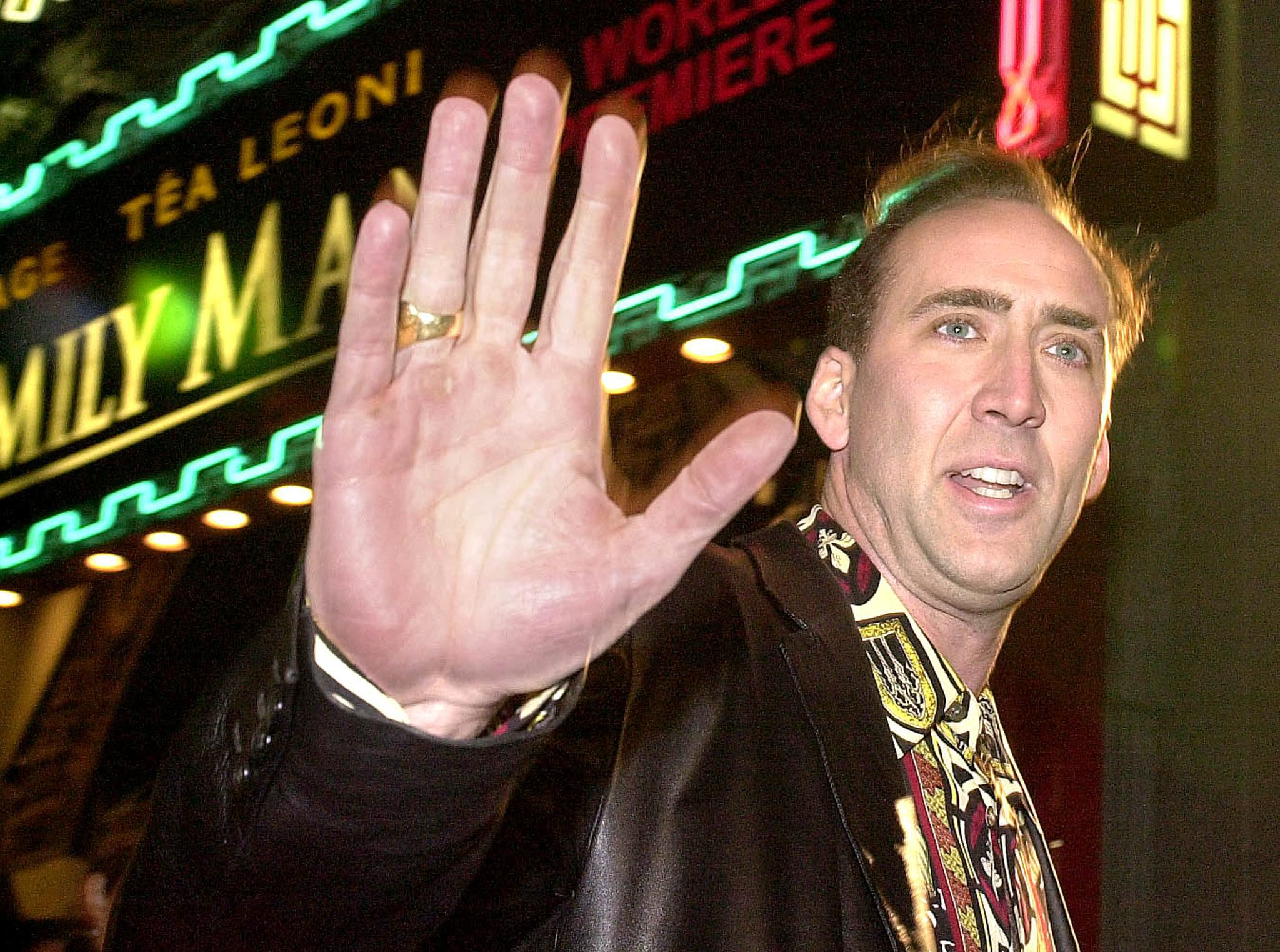 Nicolas Cage holds up his hand