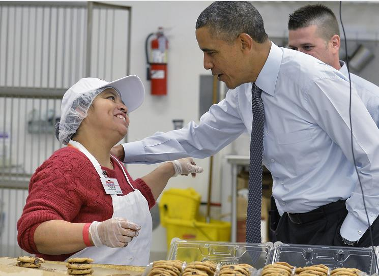 U.S. President Barack Obama greets a Costco bakery employee - Source: Pool/Getty Images