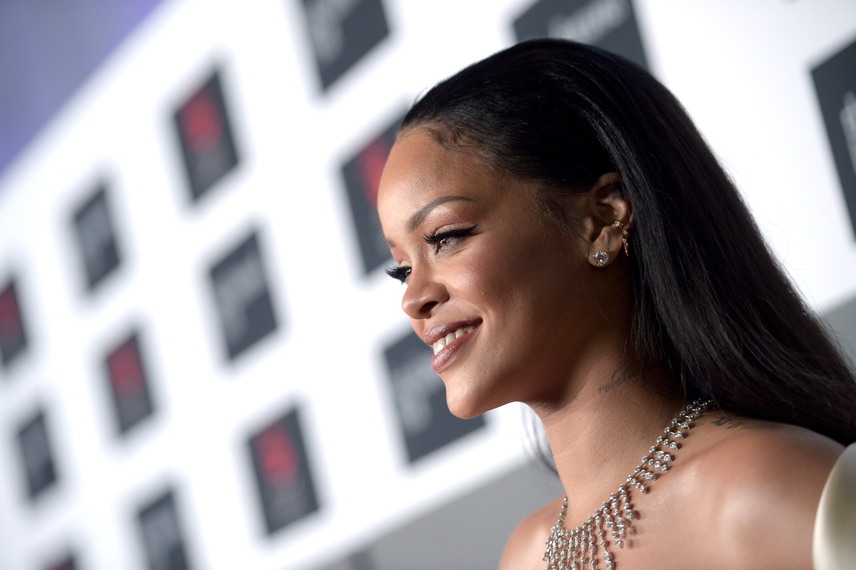 Rihanna smiling on the red carpet