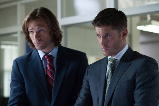 Jared Paladecki and Jensen Ackles stand next to each other in Supernatural