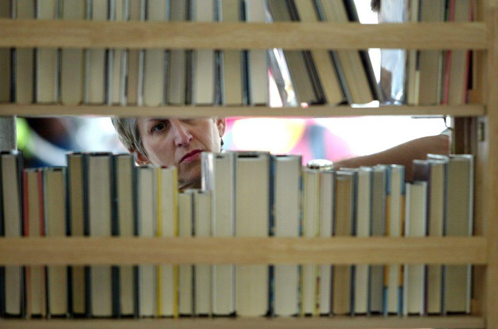 woman looking at books