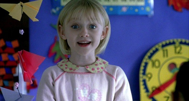 Young Dakota Fanning smiles in a scene from I Am Sam