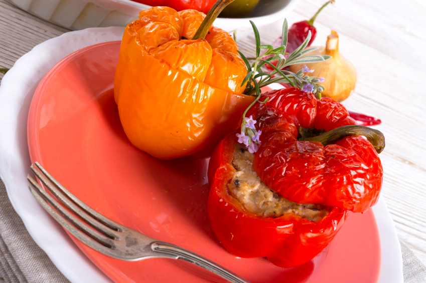 two stuffed peppers on a plate