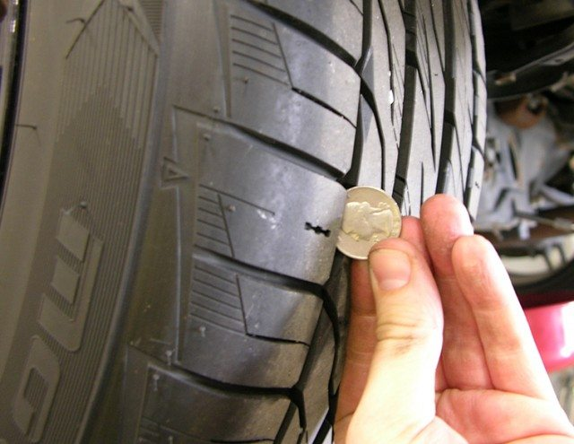 Checking tire tread with a quarter or penny is a crucial part of car ownership