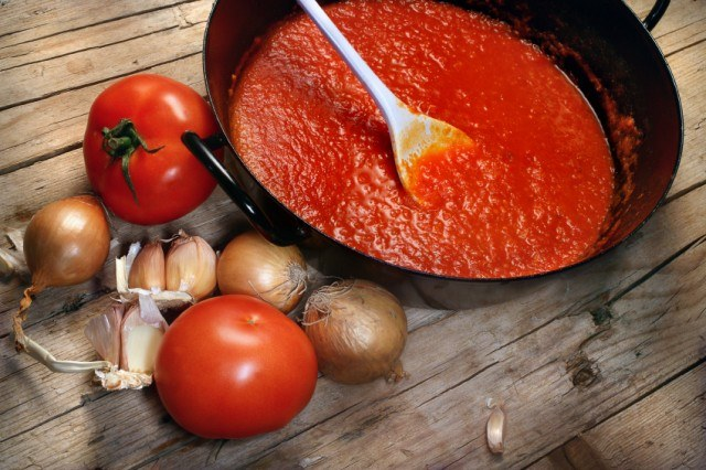skillet filled with tomato sauce