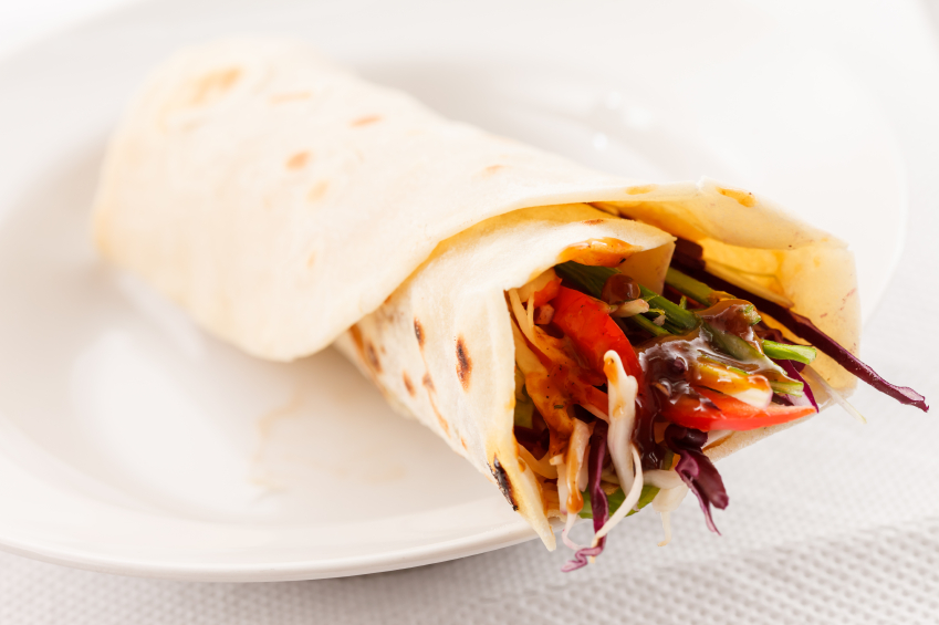 Mexican taco tortilla with meat and vegetables