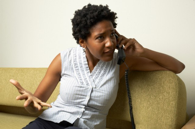 An African-American woman talks on the phone