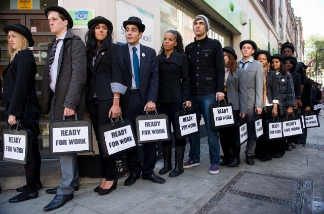 musicians Miss Dynamite (5th L) and Charlie Simpson (6th L) join unemployed young people as they stand in line outside a job centre in central London - Leon Neal/AFP/Getty Images