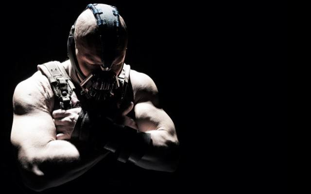 Tom Hardy wears a mask as Bane in The Dark Knight Rises