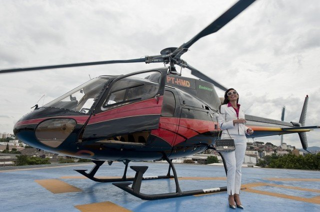 Brazilian millionaire Cozete Gomes boards her helicopter - Nelson Almeida/AFP/Getty Images