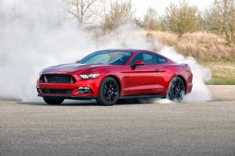 A red 2016 Ford Mustang GT tests its speed capabilities on the road