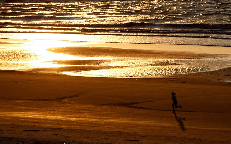 A look at a morning jogger on a South Carolina beach
