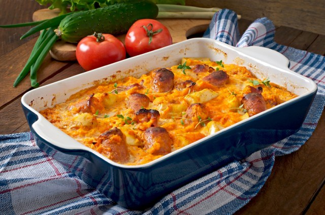 casserole dish filled with cheese and sausage strata