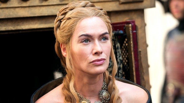 Cersei Lannister, her hair long and in braids, looks pensive in a scene from 'Game of Thrones.'