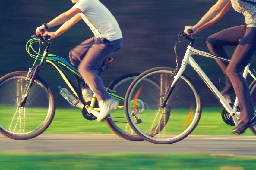 Cyclists, bike riding
