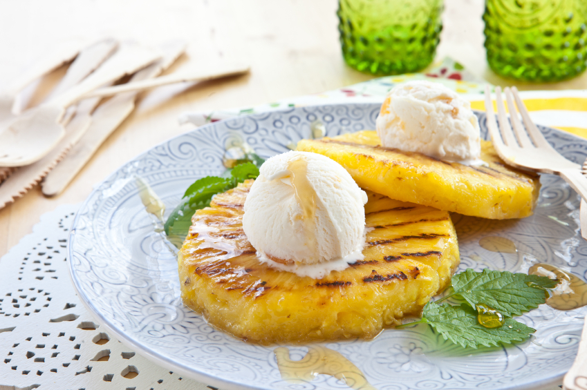 rum glazed pineapple with toasted coconut and vanilla ice cream