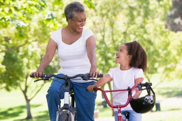 Grandmother and granddaughter riding bikes