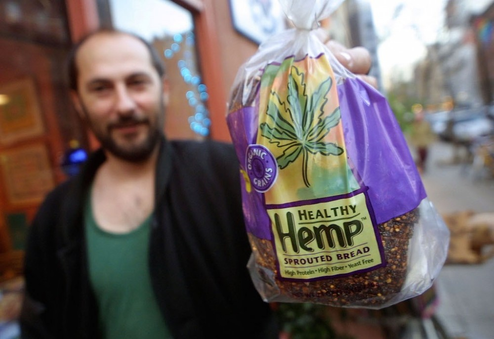 Hemp enthusiast Andrew Seidenfeld holds hemp bread at a stand promoting hemp products December 4, 2001 in New York City. The D.E.A. recently banned all hemp food products that contain THC, the active ingredient in marijuana. (Photo by Mario Tama/Getty Images)
