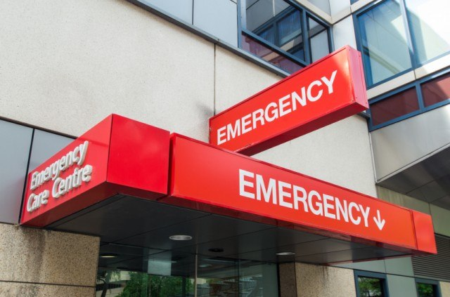 Entrance of an emergency room with red signs.