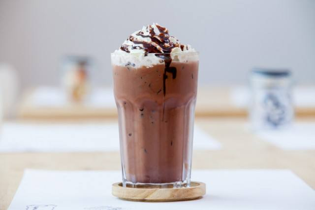 A Frappuccino with whipped cream and chocolate on top