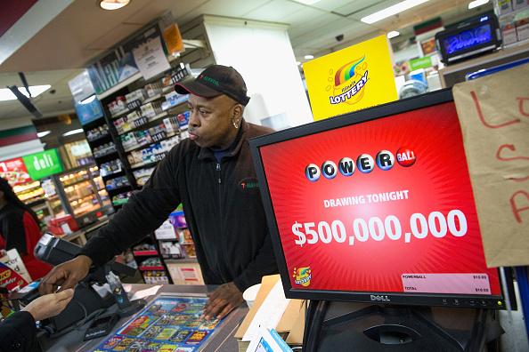 A man selling lottery tickets at a store.