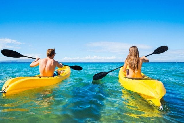 Couple kayaking on vacation