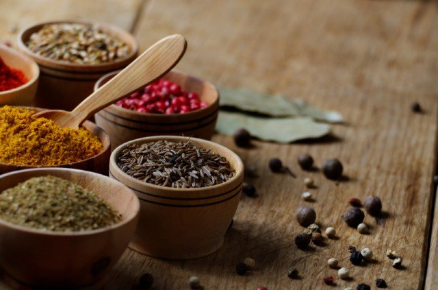 Mixed spices in wooden bowls.