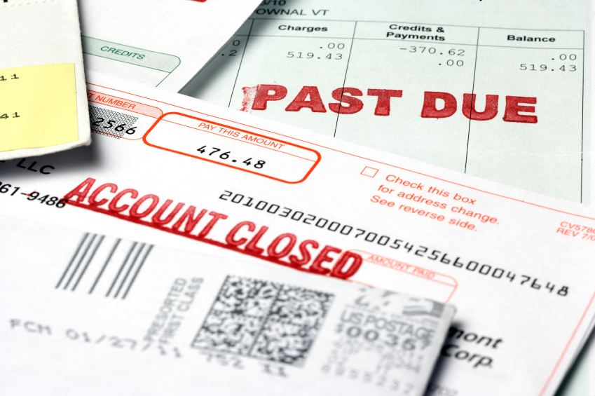 A collection of debt notices and bills