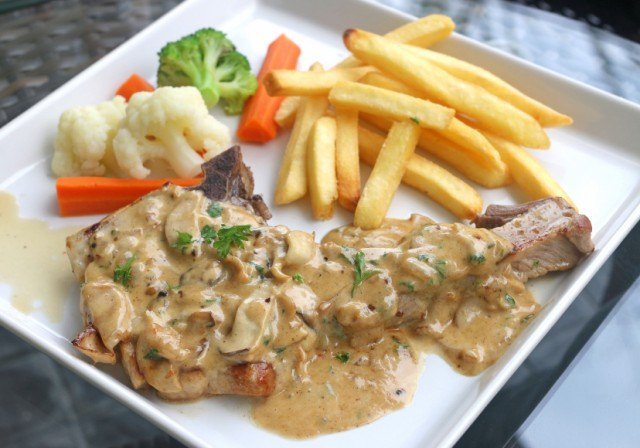 pork chops with vegetables and fries