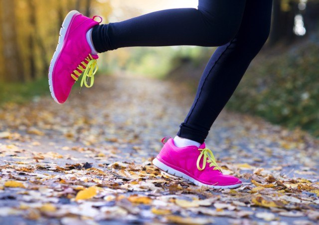 Woman wearing neon pink athletic shoes