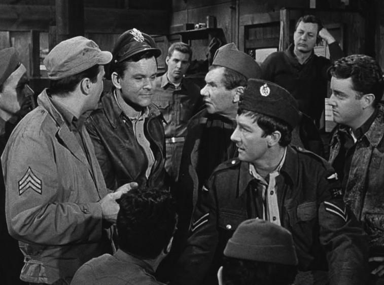 A group of World War II soldiers talk in a scene from Hogan's Heroes