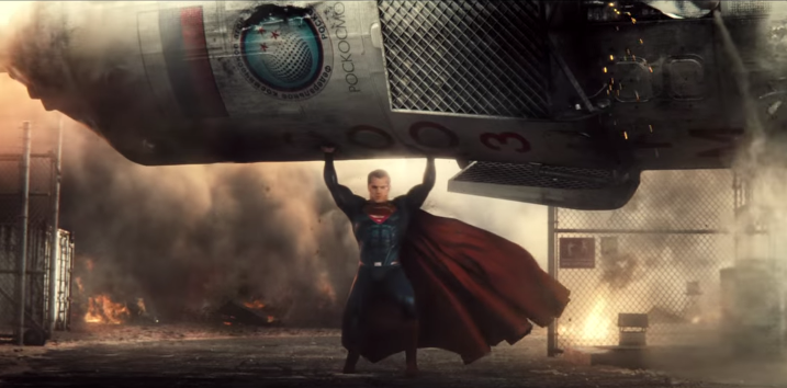 Superman lifts object over head