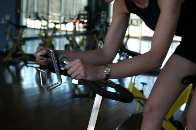 Woman at a spin class at her gym