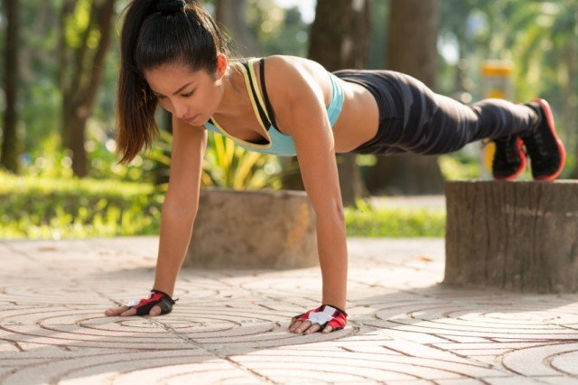 Woman performing floor exercises outside