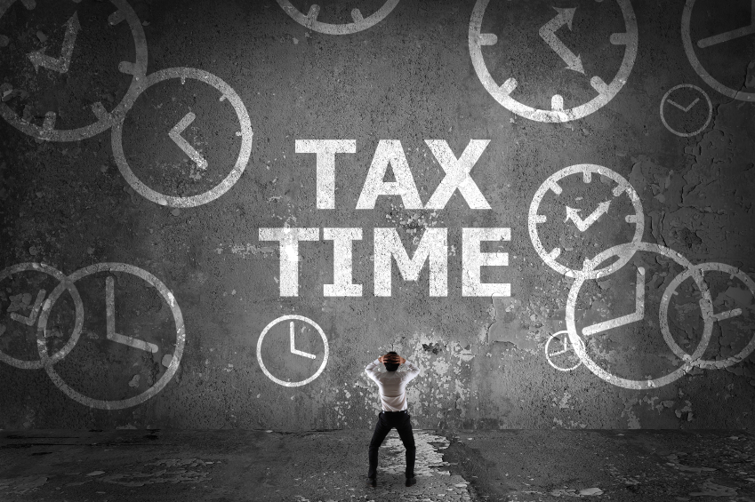 frantic man looking at tax time graphic
