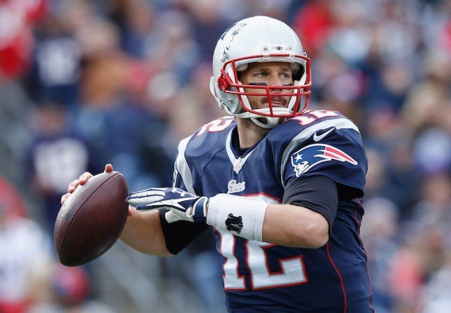 Tom Brady about to throw the football