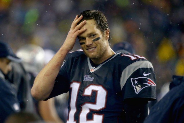 Tom Brady #12 of the New England Patriots reacts against the Indianapolis Colts of the 2015 AFC Championship Game at Gillette Stadium on January 18, 2015 in Foxboro, Massachusetts.