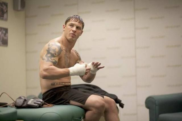 Tom Hardy bandages his hand while preparing to fight in Warrior