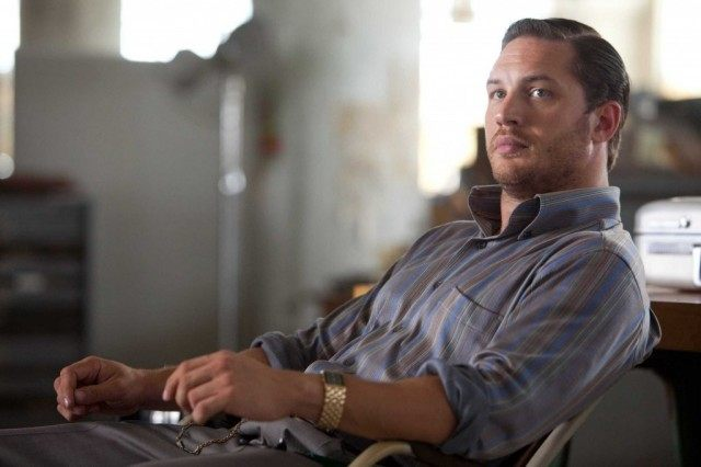 Tom Hardy leads back in a desk chair