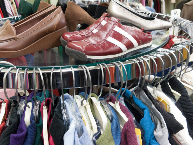a rack of clothing and shoes
